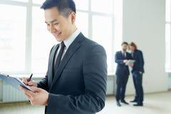 Businessman writing plan Royalty Free Stock Photography
