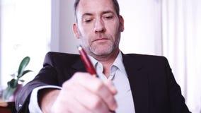 Businessman writing stock footage
