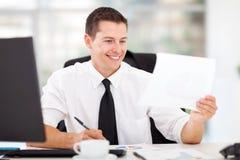 Businessman writing report Royalty Free Stock Photo