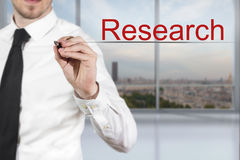Businessman writing research in the air Stock Images