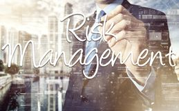 The businessman is writing Risk Management on the transparent bo Royalty Free Stock Images