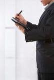 Businessman writing schedule Stock Photos