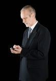 Businessman Writing Sms on Phone Stock Photos