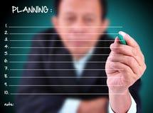 Businessman writing some planning Stock Photos