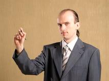 Businessman writing something Stock Image