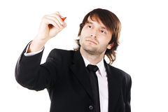 Businessman writing something with a marker Royalty Free Stock Photography