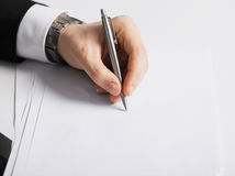Businessman writing something on the paper Stock Photo
