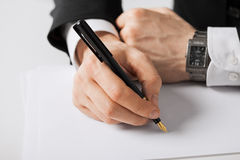 Businessman writing something on the paper Royalty Free Stock Photography
