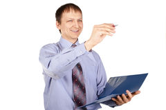 Businessman writing something with a pen Royalty Free Stock Image