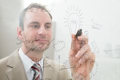 Businessman writing start up plan Stock Photography