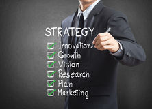 Businessman writing strategy concept Stock Images
