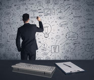 Businessman writing strategy plan on wall Royalty Free Stock Image