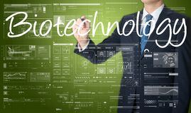 businessman writing technological terminology on virtual screen stock image