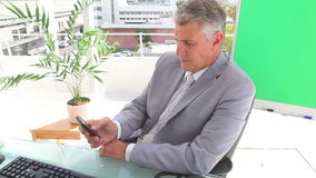 Businessman writing a text message. In an office stock video
