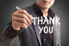 Businessman writing thank you on the screen Royalty Free Stock Photo