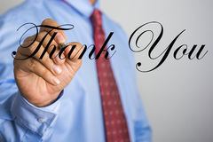 Businessman writing Thank You word on virtual screen Royalty Free Stock Photography