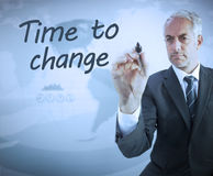 Businessman writing time to change. With a marker Stock Photo