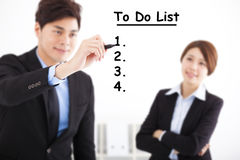 Businessman writing to do list for business plan Stock Photo