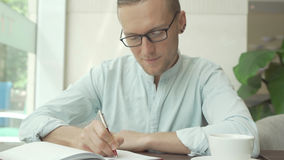 Businessman writing a to do list in a business planner. Personal organizer Royalty Free Stock Image