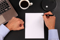 Businessman writing to notebook on a in the office. Copy space image Stock Image