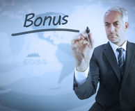 Businessman writing the word bonus Royalty Free Stock Images