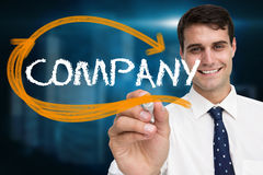 Businessman writing the word company Stock Image