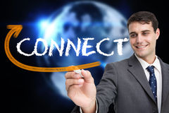 Businessman writing the word connect Stock Photography