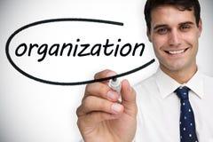 Businessman writing the word organization Stock Photo