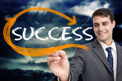 Businessman writing the word success Stock Photography