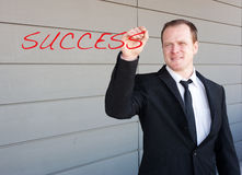 Businessman writing the word success on screen Royalty Free Stock Photo