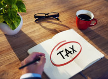 Businessman Writing the Word Tax Royalty Free Stock Images