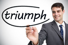 Businessman writing the word triumph Stock Photo