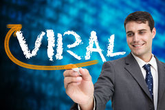 Businessman writing the word viral Stock Photography
