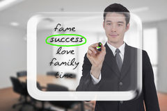 Businessman writing words success Stock Photos