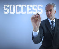 Businessman writing the words success Stock Photo