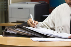 Businessman writing work paper Royalty Free Stock Images
