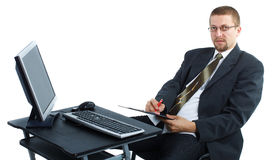 Businessman writing and working on computer Stock Images