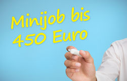 Businessman writing in yellow minijob bis 450 euro Royalty Free Stock Photos