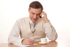 Businessman, wrote a table on a white background Stock Photography
