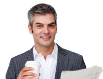 A businessman wtith newspaper and coffee Royalty Free Stock Image