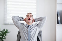 Businessman yawning Stock Image