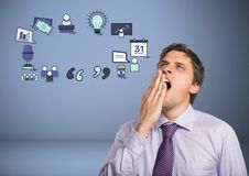 Businessman yawning tired with business graphics drawings Royalty Free Stock Photography
