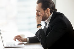 Businessman yawning while working on computer Royalty Free Stock Photography