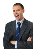 A businessman yawns. Stock Images