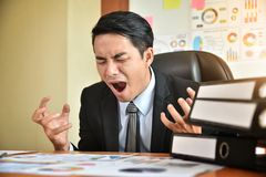 Businessman is yelling. Depressed Angry Young Asian Businessman is yelling. Angry. Stress Stock Photos