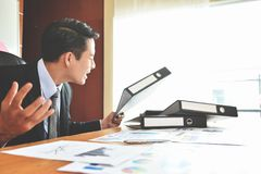 Businessman is yelling. Depressed Angry Young Asian Businessman is yelling. Angry. Stress Royalty Free Stock Photography