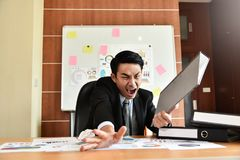 Businessman is yelling. Depressed Angry Young Asian Businessman is yelling. Angry. Stress Royalty Free Stock Image