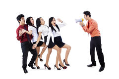 Businessman yelling at employees Royalty Free Stock Images