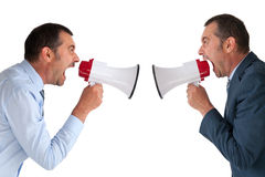 Businessman yelling at himself. Through a loudhailer Royalty Free Stock Photography