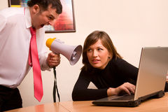 Businessman yelling on his associate at office. Businessman, may be a boss yelling on his associate at office stock images